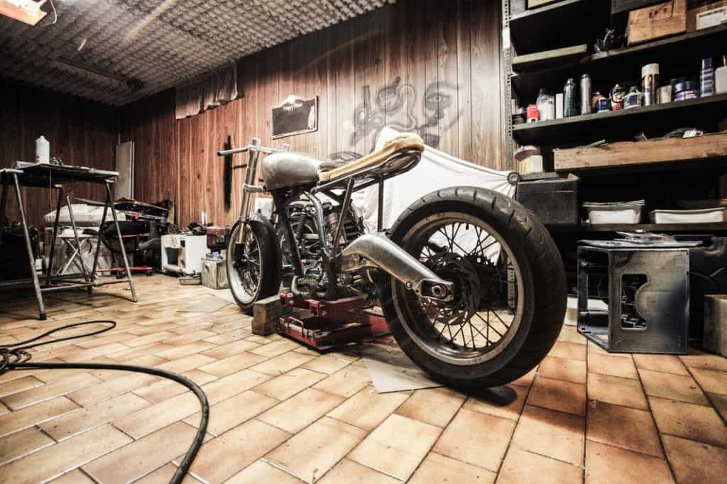 a motorcycle parked in a garage for repair